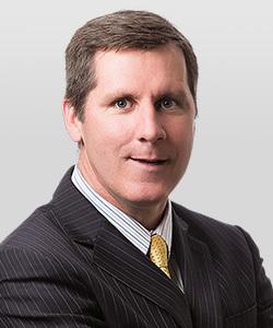 James E. Huggett